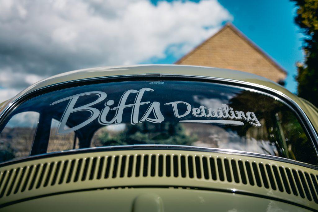 Biffs detailing sign on back windscreen of vw 67 beetle