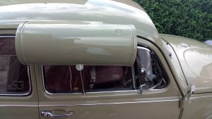 Swamp cooler attached to window of 67 beetle